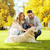 happy couple with labrador dog in autumn city park stock photo © dolgachov