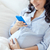 close up of pregnant woman with smartphone in bed stock photo © dolgachov