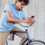 man · smartphone · vast · versnelling · fiets · straat - stockfoto © dolgachov