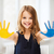 girl showing painted hands stock photo © dolgachov
