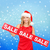 woman in santa helper hat with red sale sign stock photo © dolgachov