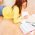 smiling teenage girl reading books on floor stock photo © dolgachov