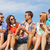 group of smiling friends with smartphones outdoors stock photo © dolgachov