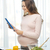 happy pregnant woman with tablet pc cooking food stock photo © dolgachov