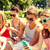 glimlachend · vrienden · smartphones · vergadering · gras · vriendschap - stockfoto © dolgachov