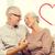 happy senior couple hugging on sofa at home stock photo © dolgachov