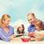 mutlu · aile · iki · çocuklar · yeme · ev · gıda - stok fotoğraf © dolgachov