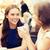 mosolyog · fiatal · nők · kávéscsészék · kávézó · kommunikáció · barátság - stock fotó © dolgachov