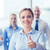 smiling businesswoman showing thumbs up in office stock photo © dolgachov