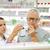 gyógyszerész · mutat · drog · idős · férfi · gyógyszertár - stock fotó © dolgachov