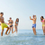 grupo · feliz · amigos · océano · playa - foto stock © dolgachov
