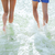 close up of human legs on summer beach stock photo © dolgachov