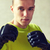 young man in boxing gloves stock photo © dolgachov