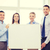 business team in office with white blank board stock photo © dolgachov