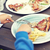 close up of child hands having dinner outdoors stock photo © dolgachov