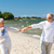 happy senior couple holding hands on summer beach stock photo © dolgachov