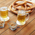 close up of beer pretzels and peanuts on table stock photo © dolgachov