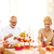 smiling family having holiday dinner at home stock photo © dolgachov
