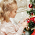 little girl decorating christmas tree at home stock photo © dolgachov