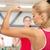 jonge · gelukkig · vrouw · spieren · tonen · sterkte - stockfoto © dolgachov