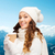 smiling young woman in winter clothes with cup stock photo © dolgachov