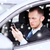zakenman · mobieltje · rijden · auto · weg - stockfoto © dolgachov