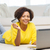 happy african woman with laptop and credit card stock photo © dolgachov