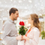 happy young couple with flowers in mall stock photo © dolgachov