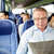 happy senior man reading newspaper in travel bus stock photo © dolgachov