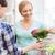 happy women choosing flowers in greenhouse or shop stock photo © dolgachov