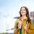 happy young woman drinking coffee on city street stock photo © dolgachov