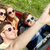 friends driving in cabriolet car and taking selfie stock photo © dolgachov