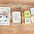 close up of notebook stickers and tablet pc stock photo © dolgachov