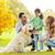 mãe · parque · cão · sorridente · flor · crianças - foto stock © dolgachov