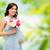 felice · donna · incinta · fiori · toccare · pancia · gravidanza - foto d'archivio © dolgachov
