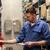 auto mechanic with clipboard at car workshop stock photo © dolgachov