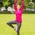 smiling woman exercising outdoors stock photo © dolgachov