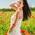 mulher · caminhada · papoula · campo · sorrindo · sorridente - foto stock © dolgachov