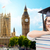 student in trencher cap with books over london stock photo © dolgachov