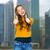 jonge · vrouw · toevallig · kleding · tonen · geluk - stockfoto © dolgachov