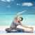 happy woman making yoga and stretching on beach stock photo © dolgachov