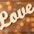 close up of word love cutout on wood stock photo © dolgachov