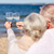 happy senior couple drinking wine on summer beach stock photo © dolgachov