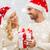 happy couple at home with christmas gift box stock photo © dolgachov