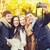 group of friends with photo camera in autumn park stock photo © dolgachov