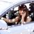 zakenvrouw · rijden · auto · mooie · brunette · geld - stockfoto © dolgachov
