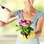 woman holding pot with flower stock photo © dolgachov