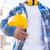close up of builder holding hardhat on building stock photo © dolgachov