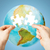 hands with white blank puzzle over earth globe stock photo © dolgachov