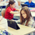 kicsi · iskolás · lány · táblagép · osztályterem · oktatás · általános · iskola - stock fotó © dolgachov